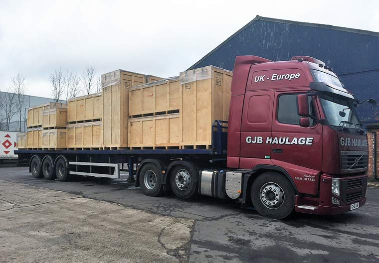 44t lorry towing a flatbed trailer
